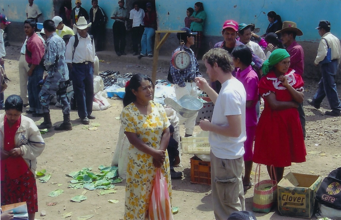 Adam talking to villagers in Guajiquiro, Honduras during his time as an urban planner for the Peace Corps.