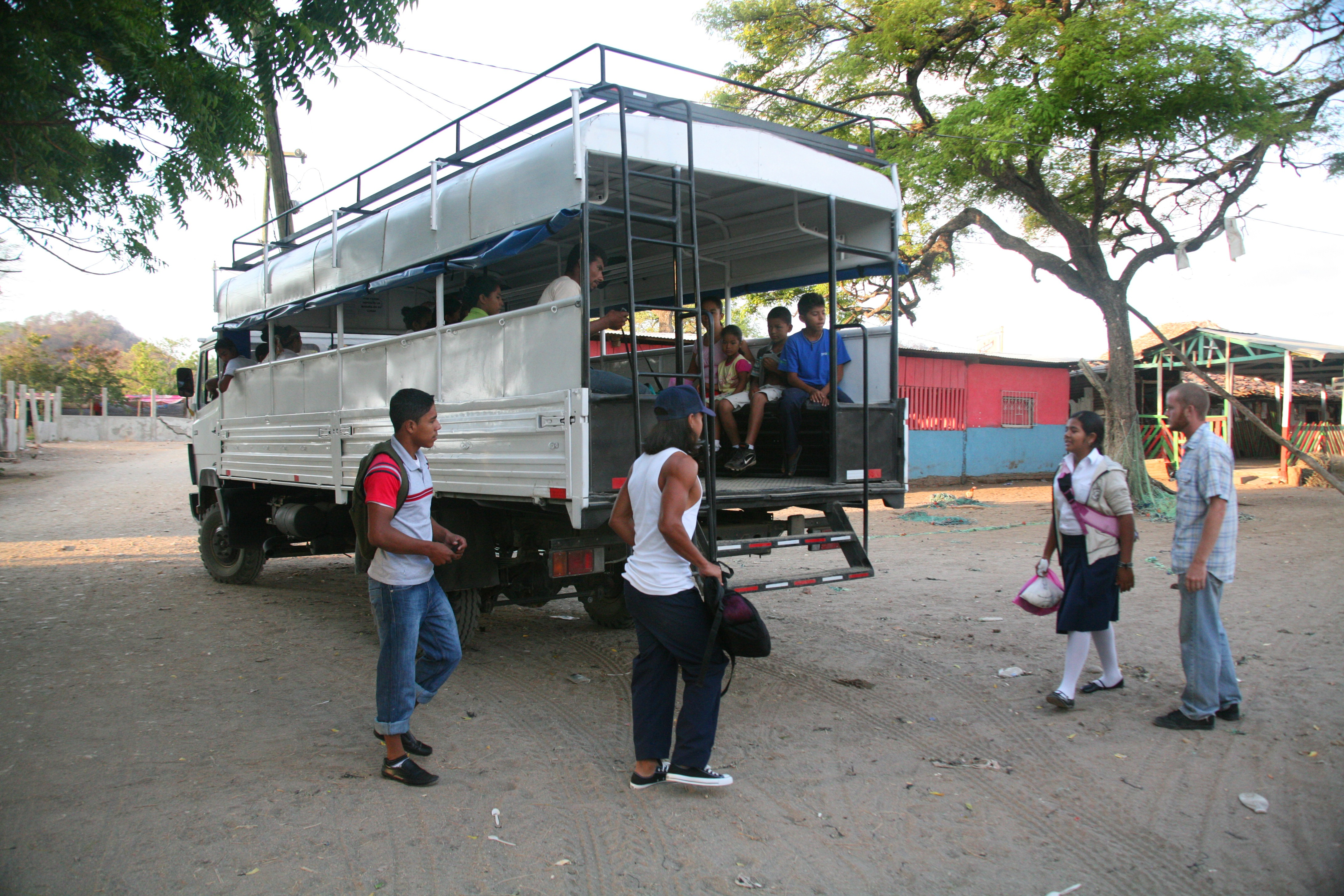 Adam stands near the bus his non-profit, Project WOO, converted for the residents of Gigante, Nicaragua