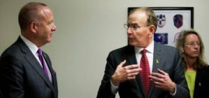Marvin Southard DSW '83 (right) speaks to Calif. Sen. Darrell Steinberg following the release of a report on mental health services in the state. Photo courtesy of Sacramento Bee