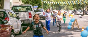 Children run in the streets of a Mexico City neighborhood as part of the peatoniños project, with streets closed for two hours of play time. Photo courtesy of Laboratorio Para La Ciudad.