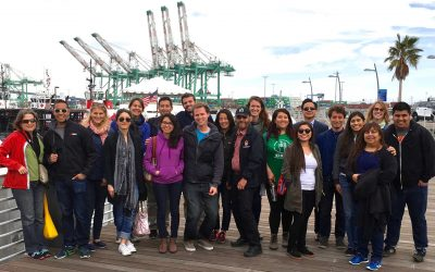 Goetz Wolff, center in black cap, with students who participated in the 2015-16 Community Scholars capstone project on the ports of Los Angeles and Long Beach.
