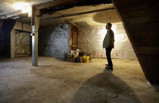 Man standing in unfinished garage