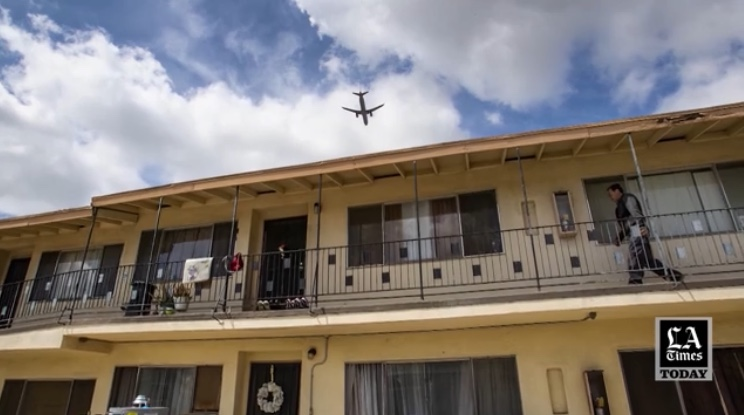 screen capture from video obtained fromthe LA Times of a plane flying over housing in Inglewood
