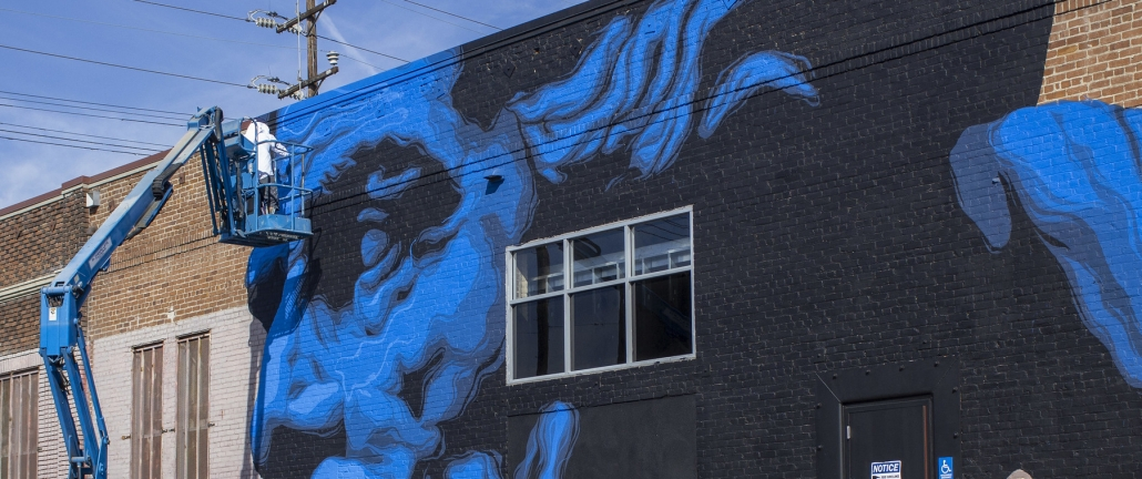Street Art Meets Climate Science In The Big Blue Face Of