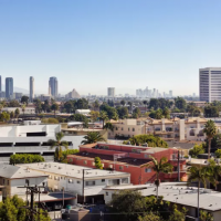 Image of housing in Los Angeles with skyline in the distance