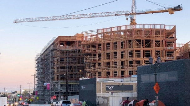 image of tent encampment outside a new building construction in Hollywood